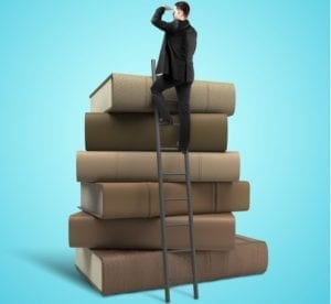 Man on a ladder looking out over all the books he is going to write, with Book Publishing Coaching by Deborah S Nelson